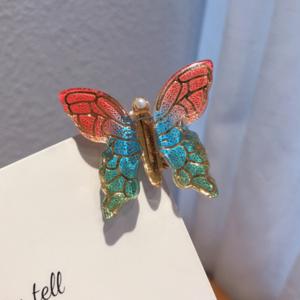 گیره مو مدل پروانه رنگارنگ در طرح های متنوع